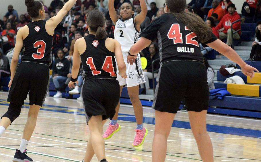 Zama's Chloe Sterling shoots over Nile C. Kinnick's Ernestina Roberts, Olivia Ouellette and Madelyn Gallo.