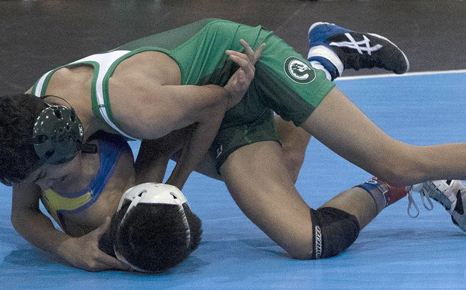 Kubasaki's Nicholaz Aguirre twists the shoulders of St. Mary's Isaac Shane toward the mat in the 101-pound Far East final. Aguirre won by technical fall 15-5.