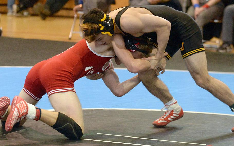 ASIJ's Rin Zoot, the reigning Far East Outstanding Wrestler, gains the advantage on Kinnick's Ethan Hamilton en route to a technical-fall victory in the 148-pound final.