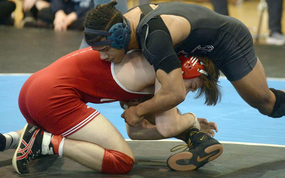 Perry's Nemo Matthews and Kinnick's Alex Lovell fight for control in the 168-pound final. Lovell won by technical fall.