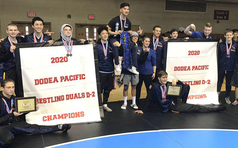 Banner time for Yokota's Far East Division II wrestling champions.