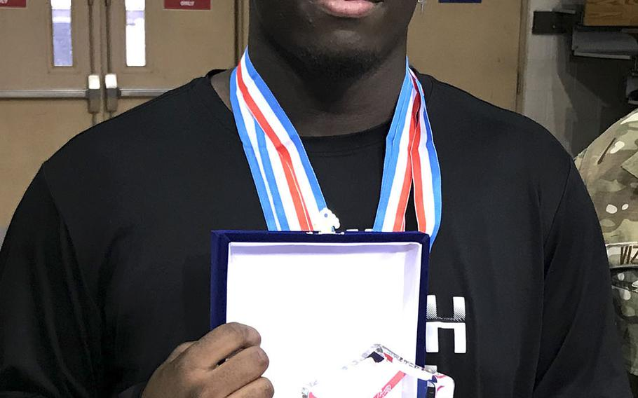 Matthew C. Perry's Marshall China, a three-time Far East wrestling tournament champion, was named the 2020 tournament's Outstanding Wrestler.