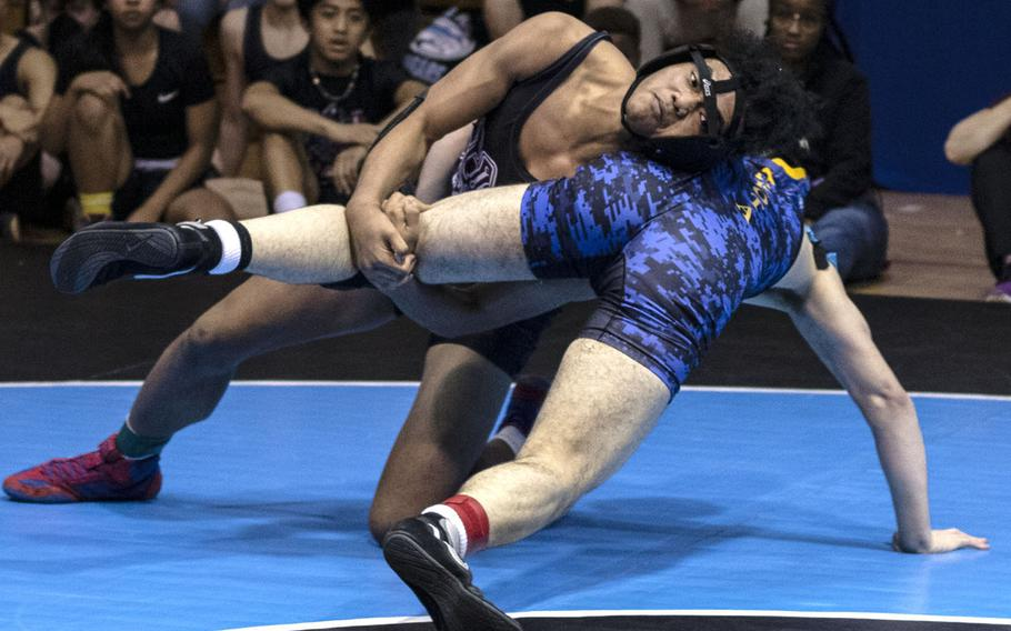 Perry's Shawn Swindell rallies for a 12-9 decision over Yokota's Liam O'Grady at 158 pounds.