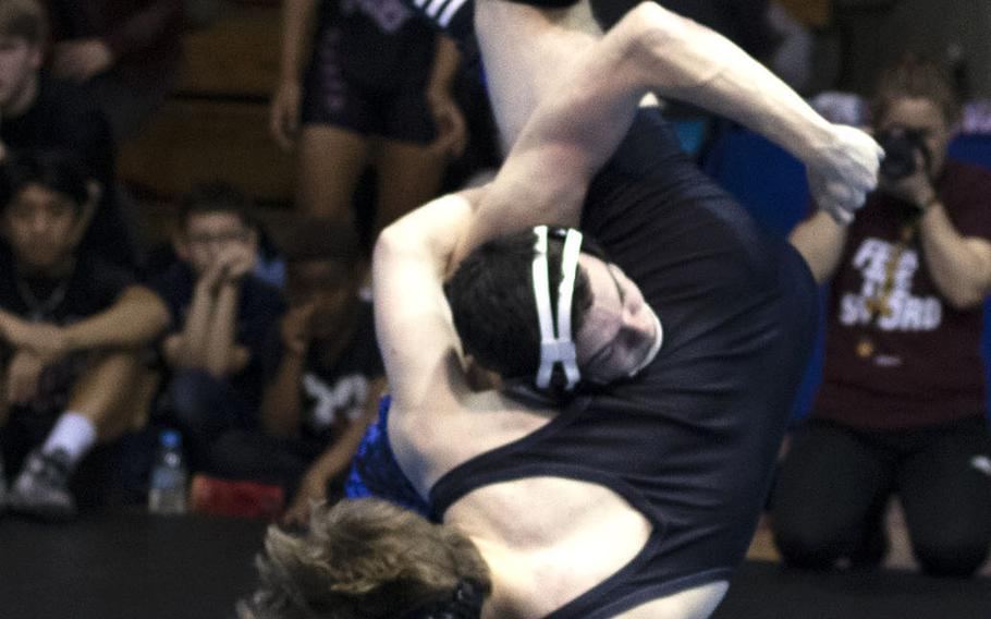 Yokota's Owen Taylor sends Perry's Parker Staley airborne en route to a 17-7 technical-fall victory at 141 pounds.