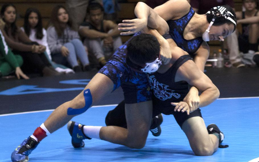 Yokota's Chris DeGrella gains the upper hand on Perry's Jaythan Baythavong en route to a pin in 2 minutes, 2 seconds at 129 pounds.