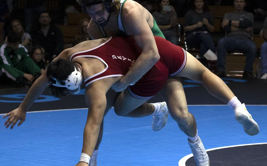 Kubasaki's Colin Nation sends Kinnick's Kaleb Leon Guerrero tumbling en route to a pin victory in 1 minute, 3 seconds at 180 pounds.