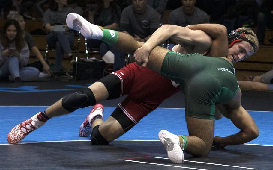 Kinnick's Ethan Hamilton scores a 13-2 technical-fall win over Kubasaki's Ruben Saavedra at 148 pounds.