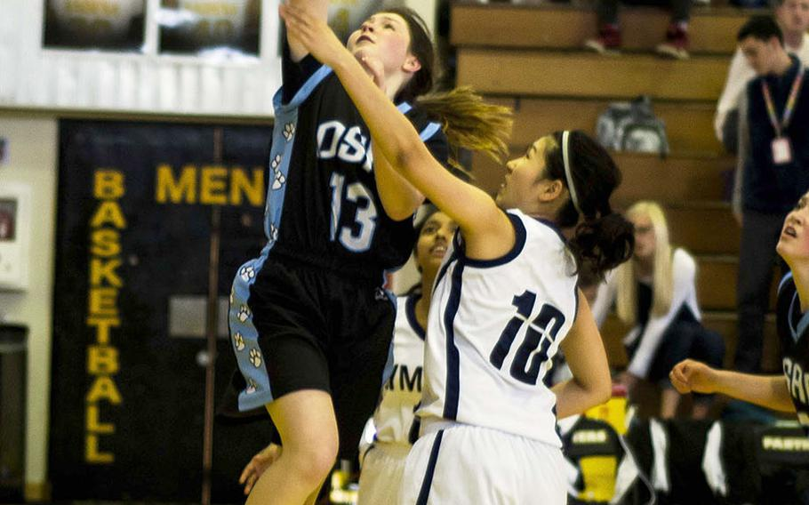 Osan's Kennedy Liddell shoots past two Sacred Heart defenders during the Symbas' 39-6 win over the Cougars.