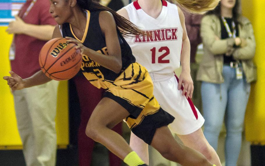 Kadena's Christee Dervil dribbles past Kinnick's Paige Drumm during the Panthers 49-37 win.