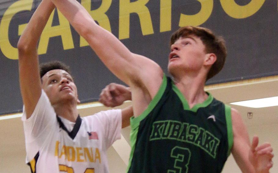 Kubasaki's Micah Moore snatches a rebound from Kadena's Tristan Higginson during the Panthers' 64-30 win.