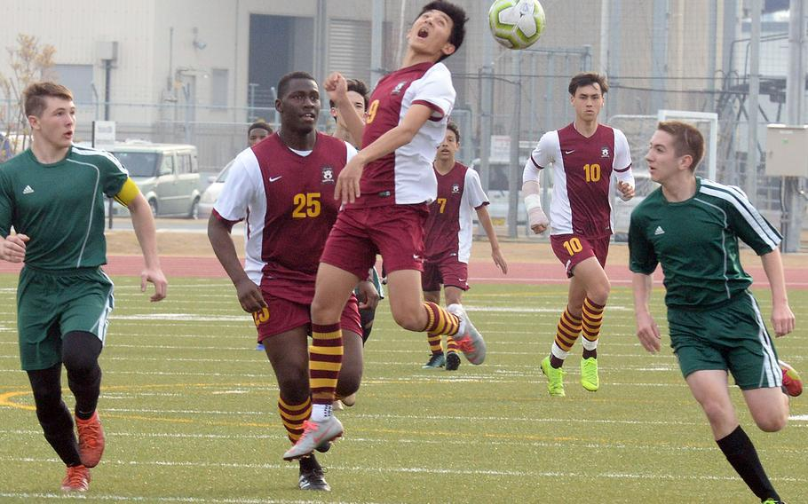 Matthew C. Perry's Yugo Cooley heads the ball between Robert D. Edgren defenders during a 2019 Perry Cup boys soccer match at Marine Corps Air Station Iwakuni. The decision to postpone all activities involving student travel for schools in the Department of Defense Education Activity's Japan district through the end of March 2020 effectively ends Matthew C. Perry High School's bid to host the eighth annual Perry Cup, officials said.