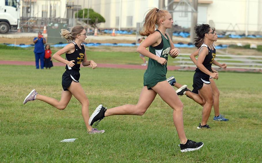 Kadena freshman Sierra Taysom at far right leads the girls pack off the start line during Friday's season-opening Okinawa cross country meet.