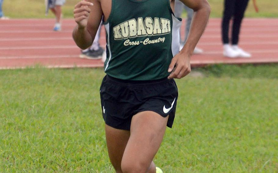 Kubasaki senior Arthur Parra races for the finish line during Friday's Okinawa cross country race at Kadena Air Base. Parra remained unbeaten among boys in three races, clocking 17 minutes, 00.05 seconds.