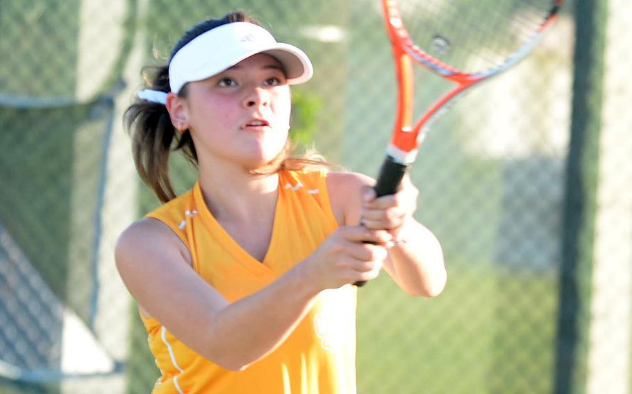 Kadena's Hana Breines hits an overhead backhand against Kubasaki's Emi Nichols during Tuesday's Okinawa tennis. Breines won 8-2.