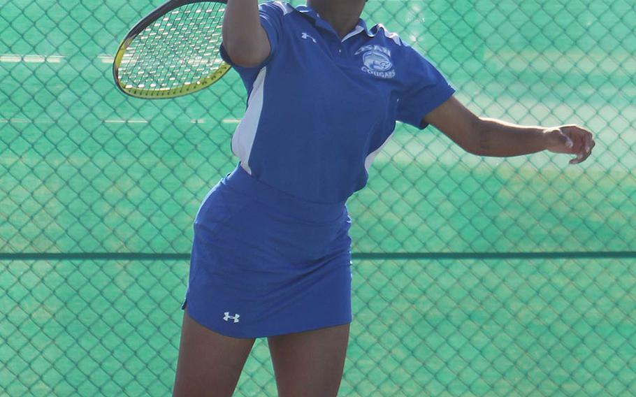 Osan's Layla Barker serves against Humphreys' Ashley Kim during Friday's DODEA-Korea season-opening tennis matches. Kim won 8-1.