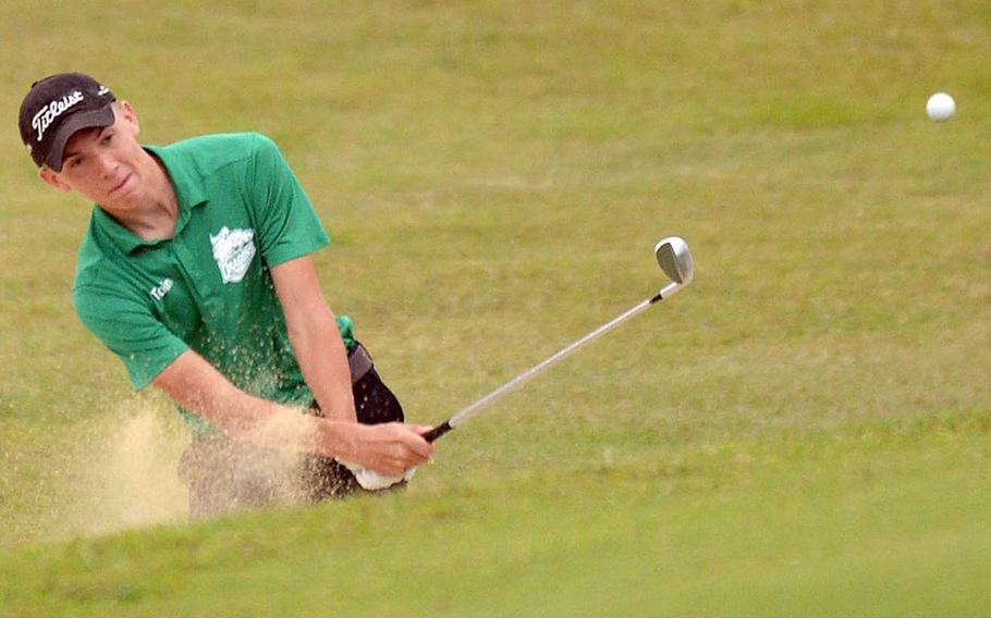 Kubasaki's Bryce Tobin blasts out of the bunker on the 468-yard, par-5 10th hole during Thursday's Okinawa golf at Taiyo Golf Club, Gushikawa. Tobin beat Kadena's Beau Black 1-up in the 9-hole match-play event.