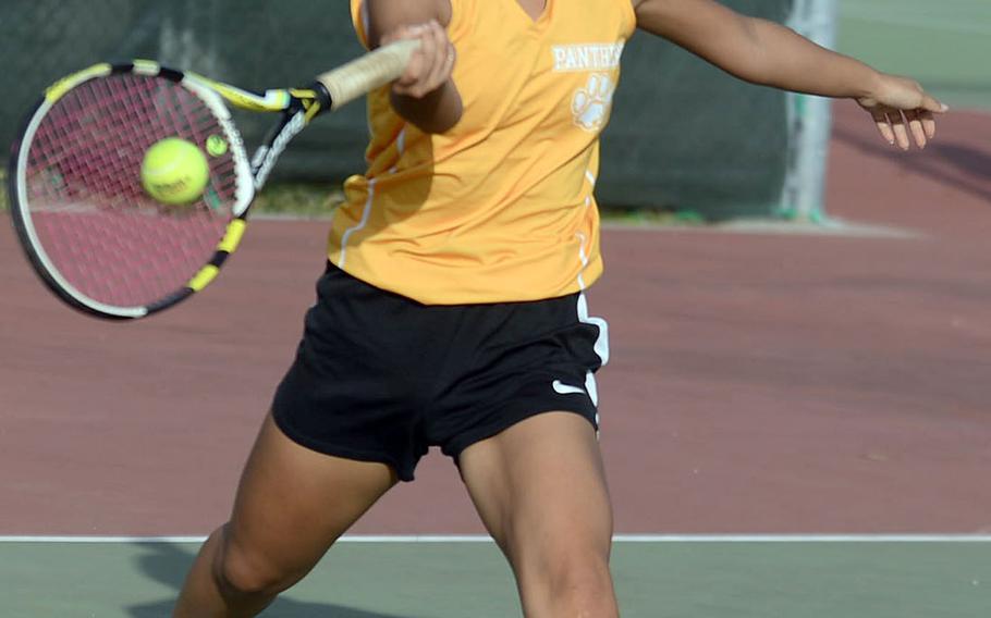 Kadena's Noelle Asato strikes a forehand return against Kubasaki's Willow Lewis during Tuesday's Okinawa tennis. Asato won 8-6.