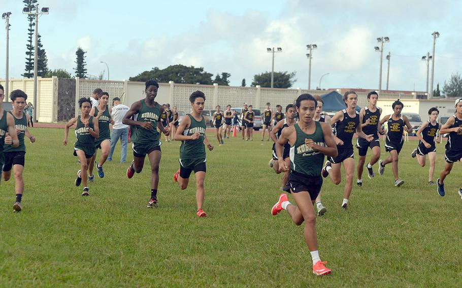 Kubasaki's Arthur Parra leads the pack off the start line of Friday's Okinawa boys cross country race. Parra won for the fifth straight week, clocking 17 minutes, 24. 91 seconds.