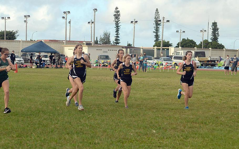 Kubasaki's Jessica Nation, far left, and Kadena's Isamar Vargas, far right, flank the field of runners at the start of Friday's Okinawa girls cross country race. Vargas finished third in 23 minutes, 12.33 seconds and Nation fifth in 23:34.30.