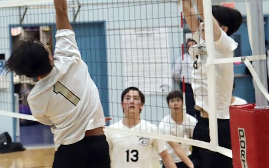 Humphreys Gold's Cesar Edgerton Diaz Lorenzo spikes against Osann's Timothy Petrae during Wednesday's Korea volleyball. Gold won 25-22, 25-22.
