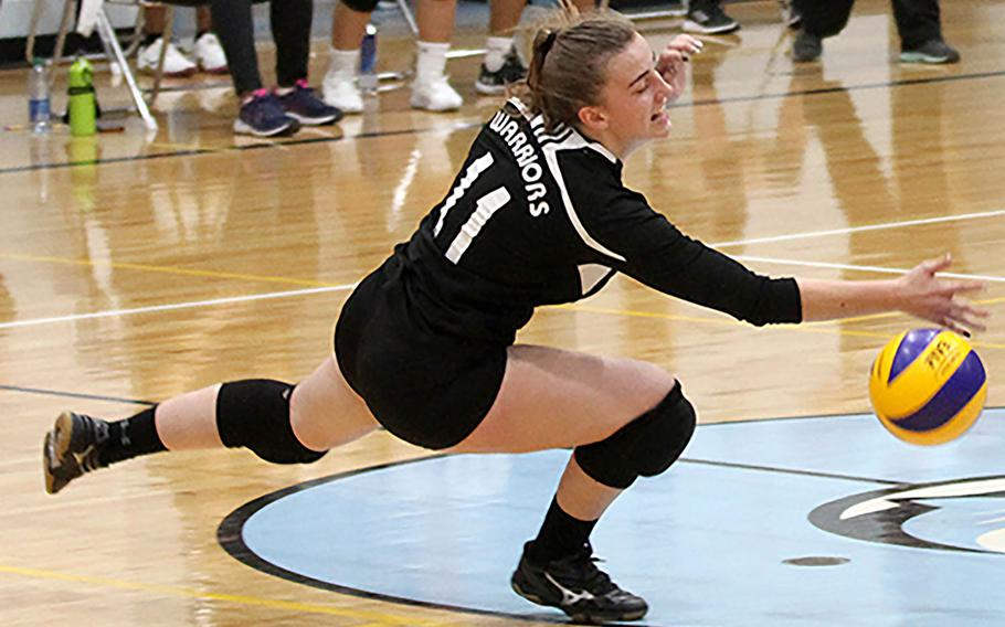 Daegu's Lexie Berry can't find the handle on the ball against Osan Black during Friday's DODEA-Korea girls volleyball. Osan Black beat the Warriors 22-25, 25-23, 25-21.