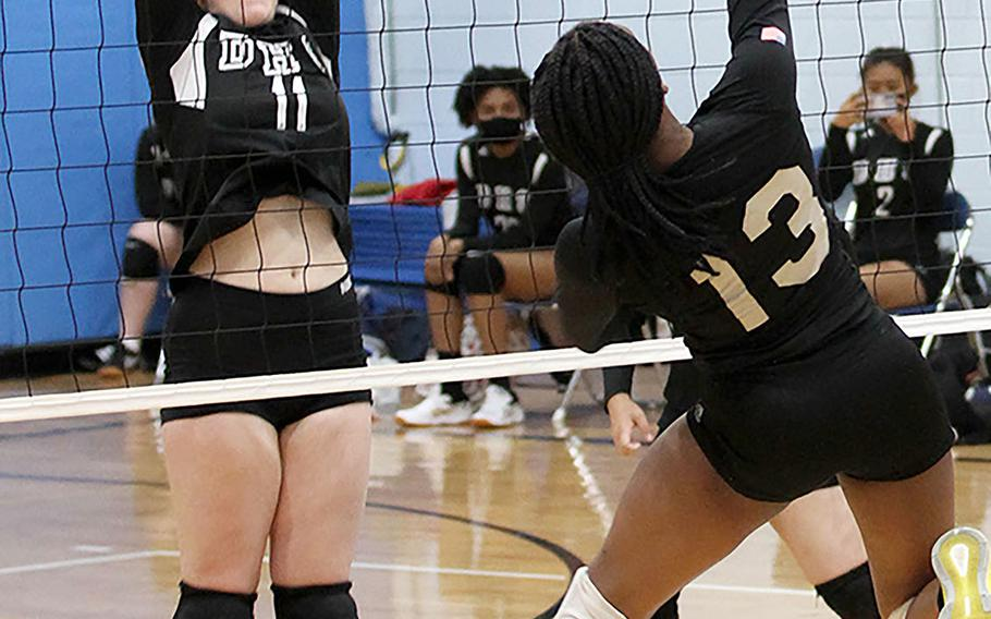 Osan Black's Tailan Hickey goes up to hit against Daegu's Lexie Berry during Friday's DODEA-Korea girls volleyball. Osan Black beat the Warriors 22-25, 25-23, 25-21.
