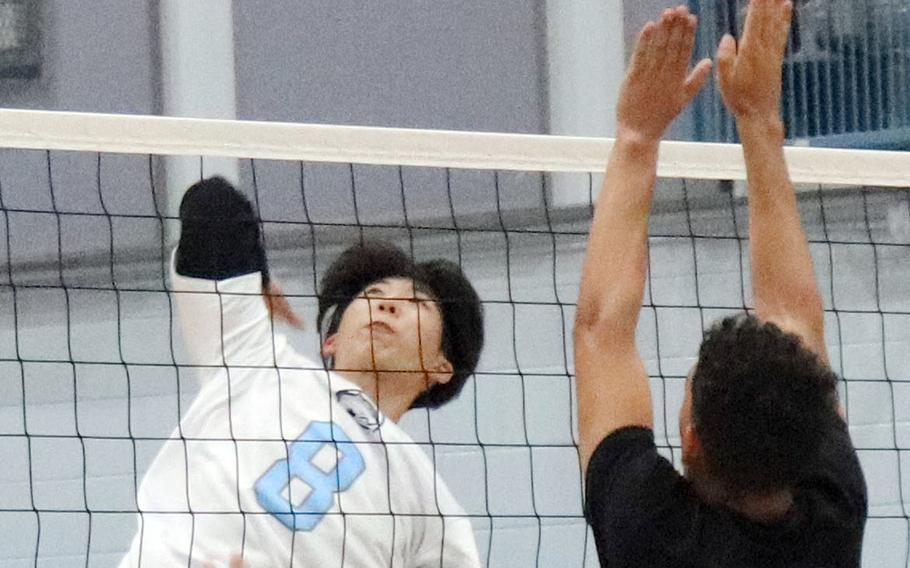 Osan's Tim Petrae tries to hit past Daegu's Jordan Brown during Friday's Korea boys volleyball match. The Cougars beat the Warriors 26-24, 25-16.