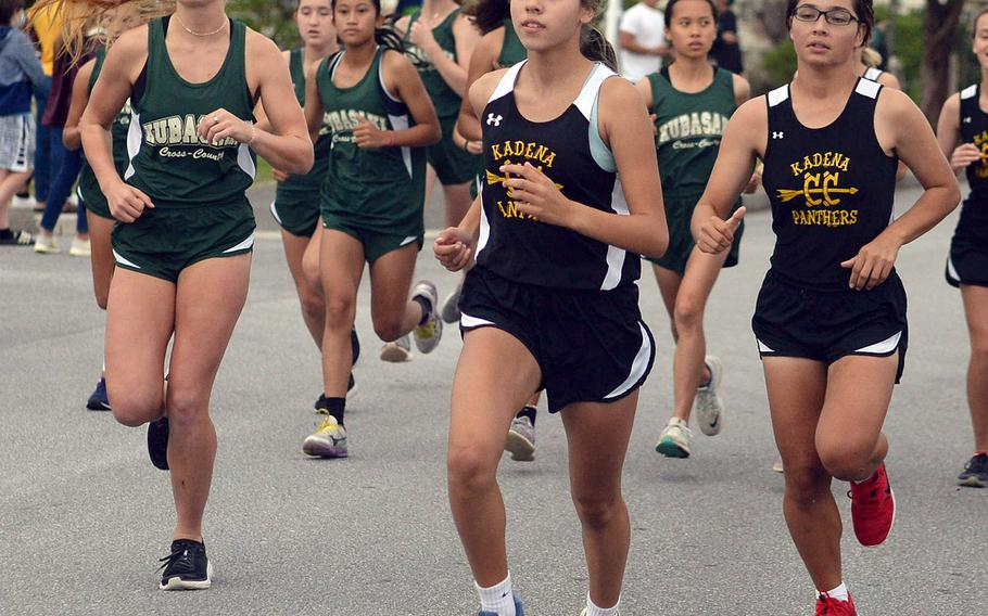 Kubasaki's Jessica Nation and Kadena's Karise Johnson and Isamar Vargas lead the pack off the start line of Friday's Okinawa cross country meet. Johnson won her third race of the season in 20 minutes, 7.67 seconds; Vargas took third in 21:54.84 and Nation fourth in 21:59.67.