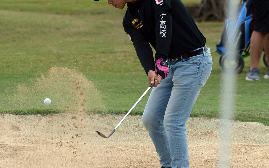 Kadena's Austin Barnes blasts out of a bunker near the third green during Thursday's Okinawa golf at Chibana's par-3 course. Barnes shot 36 and finished third.