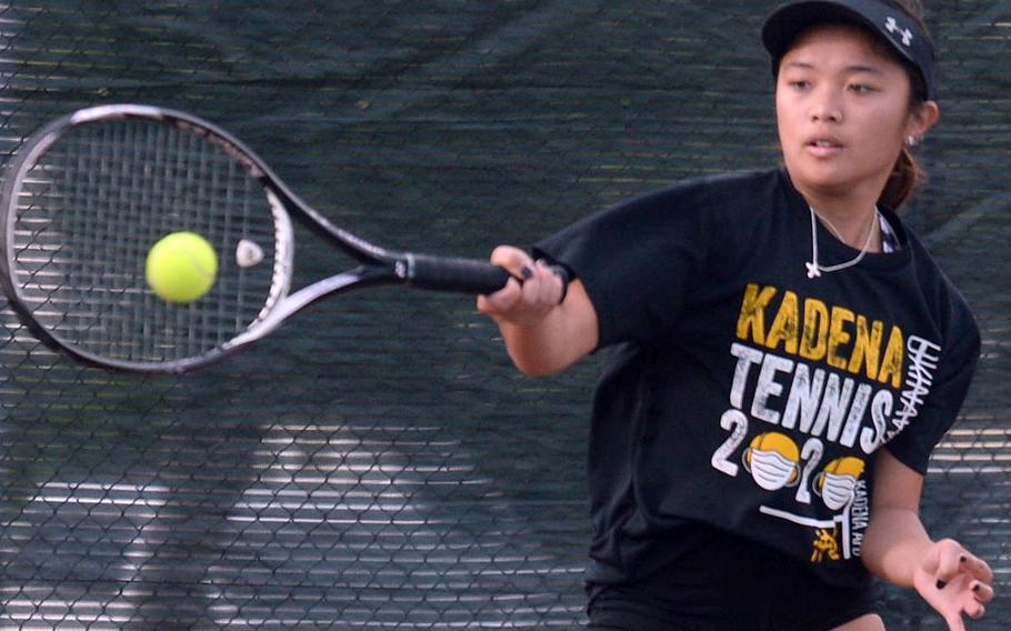 Kadena senior Mayann Rivera smacks a forehand return against teammate Noelle Asato during a knockout-bracket match Wednesday in the Okinawa district singles tennis tournament. Asato eliminated Rivera 6-4.