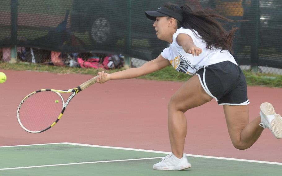 Kadena senior Noelle Asato lunges for a forehand groundstroke against teammate Mayann Rivera during a knockout-bracket match Wednesday in the Okinawa district singles tennis tournament. Asato won 6-4, but lost in the final to Kubasaki's Willow Lewis 8-2.