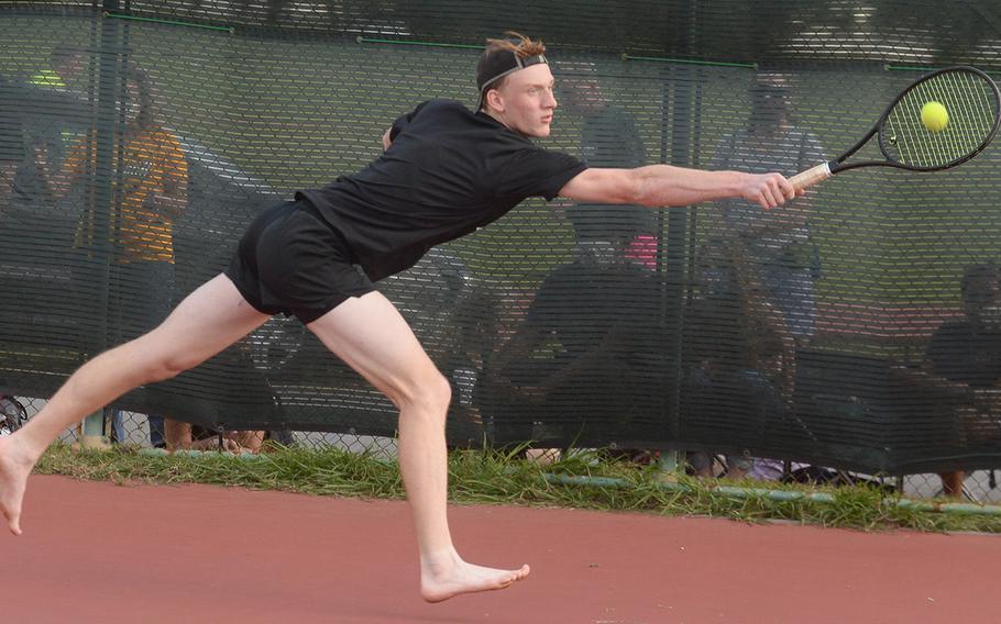 Kadena senior Brett Davis lunges for a backhand -- in bare feet -- against teammate R.J. Smola in a knockout-bracket match Wednesday in the Okinawa district tennis singles tournament. Smola beat Davis in a tiebreak 7-6 (8-6).