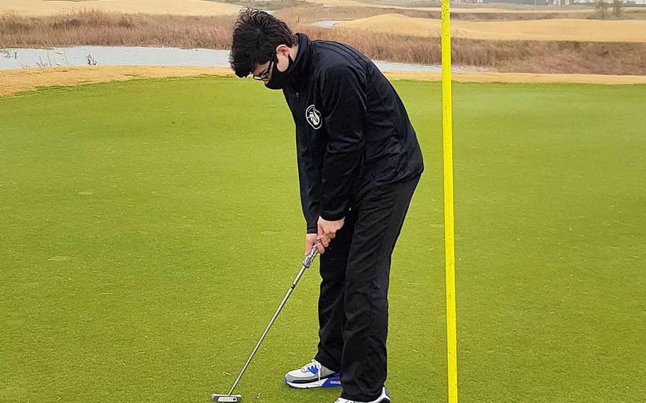 Humphreys Black's Blake Borelli putts during Thursday's DODEA-Korea golf match. Borelli halved his match with Humphreys Gold's Isaac Kim.