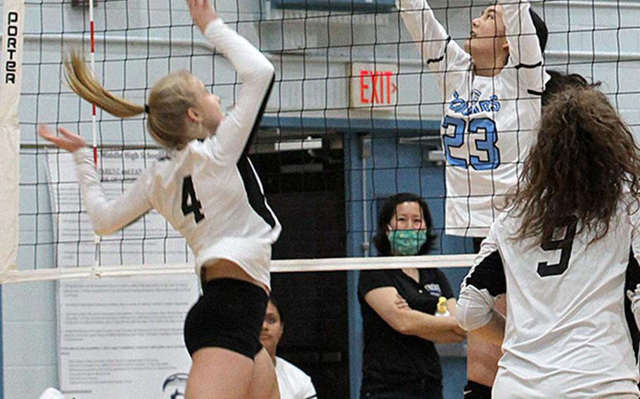 Humphreys' Zoe Weidley and Osan's Shaylee Ungos battle for the ball during Wednesday's DODEA-Korea volleyball match. Osan's Black team swept Humphreys' Gold and Black teams in two three-set matches. Humphreys' teams repaid the favor, beating Osan Blue in a pair of two-set matches.