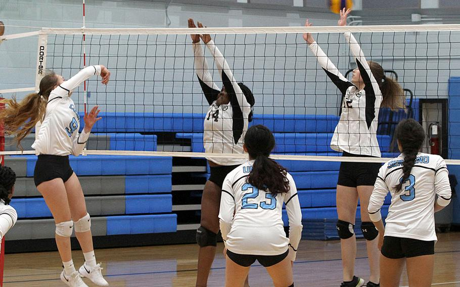 Osan's Naomi Elliot spikes over Humphreys' Janae Bennet and Bridgette Elkins during Wednesday's DODEA-Korea volleyball match. Osan's Black team swept Humphreys' Gold and Black teams in two three-set matches. Humphreys' teams repaid the favor, beating Osan Blue in a pair of two-set matches.