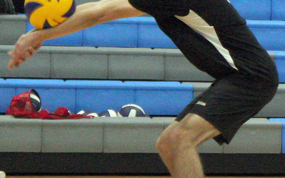 Humphreys' Chase Tabor bumps the ball against Osan during Wednesday's DODEA-Korea volleyball. The Cougars swept two matches, beating Humphreys Gold 25-20, 27-25 and Humphreys Black 25-21, 28-26.