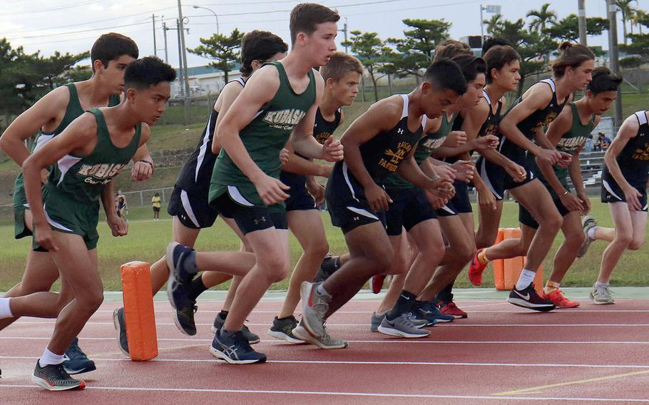 Kubasaki and Kadena boys runners come off the start line during the Far East cross country meet qualifier on Nov. 21. Kadena junior Joe Renquist, third from right, won that meet and posted the fastest boys Division I time of 17 minutes, 31.5 seconds.