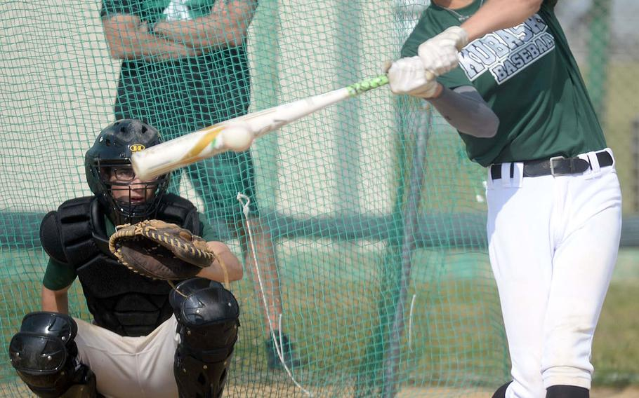 Kubasaki sophomore Jeffrey Owens takes his cuts during a Wednesday practice, under the watchful eye of longtime Dragons coach Randy Toor with senior Nick Patton behind the plate.