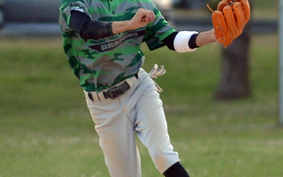 Kubasaki second baseman Nick Adams fires a throw to first base against Kadena during Thursday's Okinawa baseball game. The Dragons won 6-1.