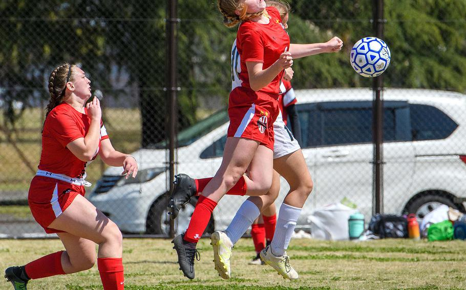 Nile C. Kinnick's Breeanne Withers tries to settle the ball against Zama during Saturday's battle of reigning Far East girls soccer tournamernt champions. The Division I Red Devils blanked the Division II Trojans 6-0.