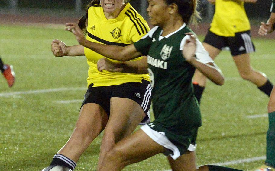 Kubasaki's Natalie Oboza and Kadena's Mikayla Benitez chase down the ball during Friday's Okinawa girls soccer match. The Panthers won 3-0.