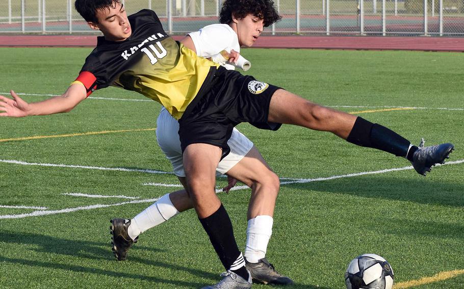 Kadena's Gideon Summers and Kubasaki's Thiago Facchini scrum for the ball during Friday's Okinawa boys soccer match. The Dragons won 3-0.