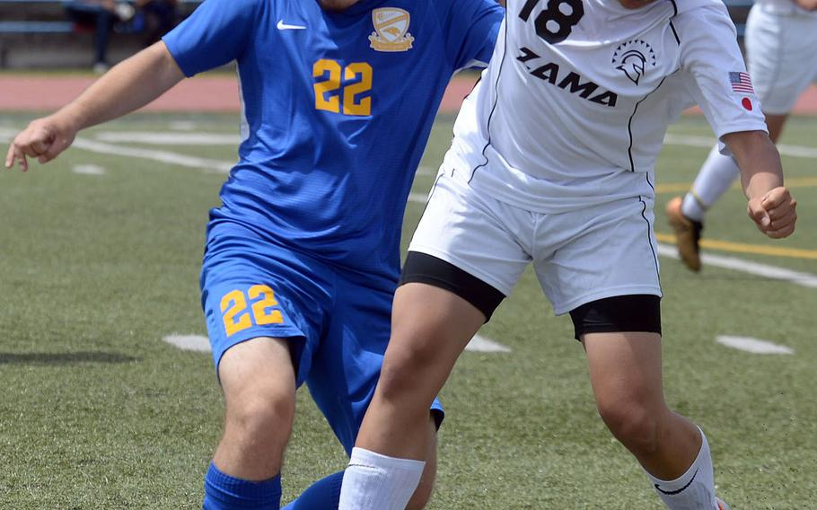 Zama's Kaisei Muta and Yokota's Joey Nishida battle for the ball during Saturday's DODEA-Japan boys soccer match. The Trojans and Panthers played to a 2-2 draw.