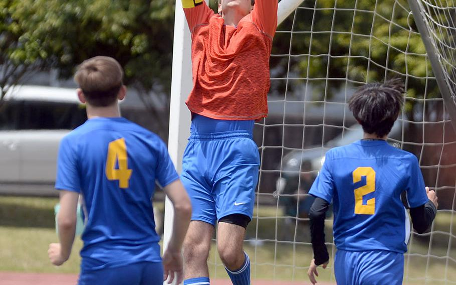 Yokota goalkeeper Tanner Marlowe skies to make the save against Zama during Saturday's DODEA-Japan boys soccer match. The Panthers and Trojans played to a 2-2 draw.