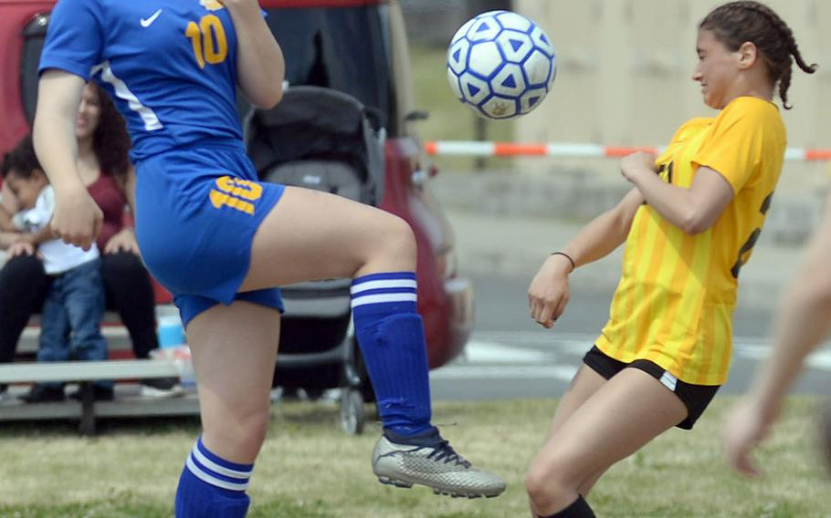 Yokota's Lucy Wellons and Robert D. Edgren's Lely Rivera battle for the ball during Saturday's DODEA-Japan girls soccer match. The Eagles beat the Panthers 3-1, and Yokota rebounded for a 5-1 win to split the series.
