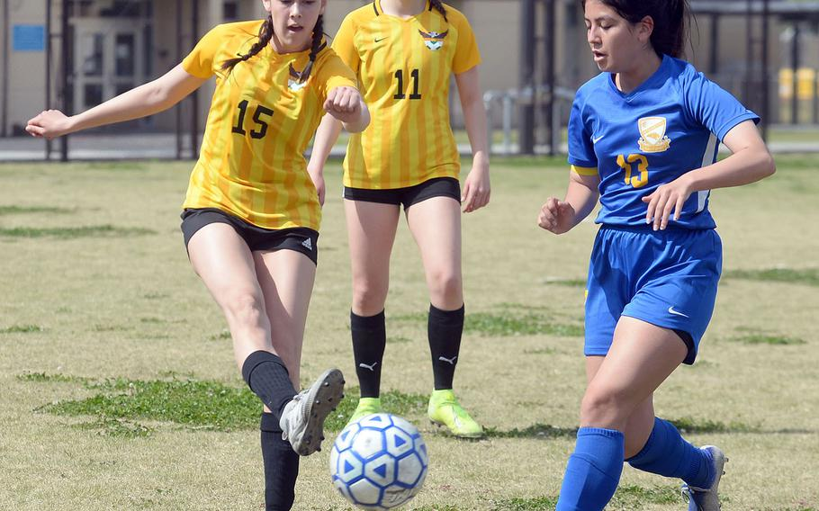Robert D. Edgren's Maya Smith boots the ball past Yokota's Keiya Carlson during Saturday's DODEA-Japan girls soccer match. The Eagles beat the Panthers 3-1, and Yokota rebounded for a 5-1 win to split the series.