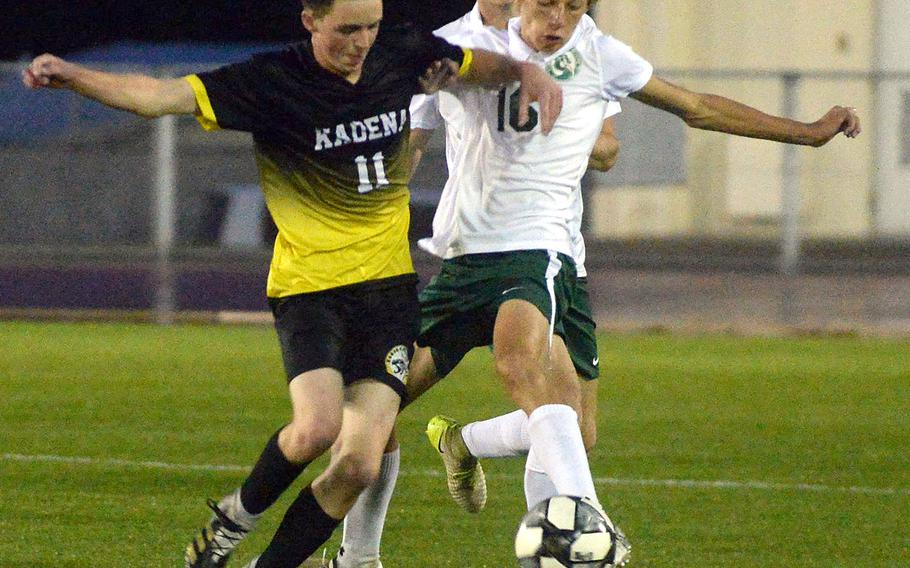 Kadena's Nathan Funkhouser and Kubasaki's Jacob Czepiel battle for the ball during Thursday's DODEA-Okinawa boys soccer season finale. The Dragons won 1-0, capturing the season series 3-1 with one draw.