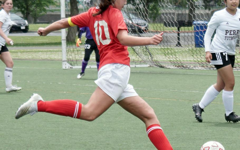 E.J. King's Mali Schinker boots the ball against Matthew C. Perry during Saturday's DODEA-Japan girls soccer matches. The Cobras won both matches 6-0 and 3-0, capping an 8-0 sweep of their matches with the Samurai.