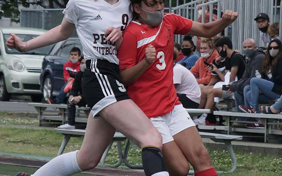 Matthew C. Perry's McKenzie Mitchell and E.J. King's Alyssa Garcia chase the ball during Saturday's DODEA-Japan girls soccer matches. The Cobras won 6-0 and 3-0, capping an 8-0 season-series sweep over the Samurai.