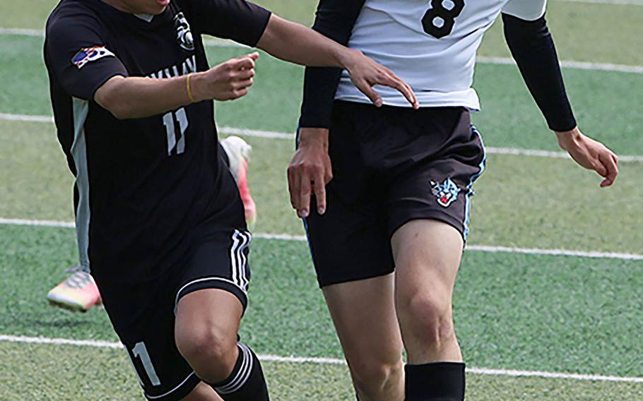 Humphreys' Tony Oh and Osan's Timothy Petrae battle for the ball during Saturday's DODEA-Korea boys soccer championship match. The Blackhawks won 2-0.